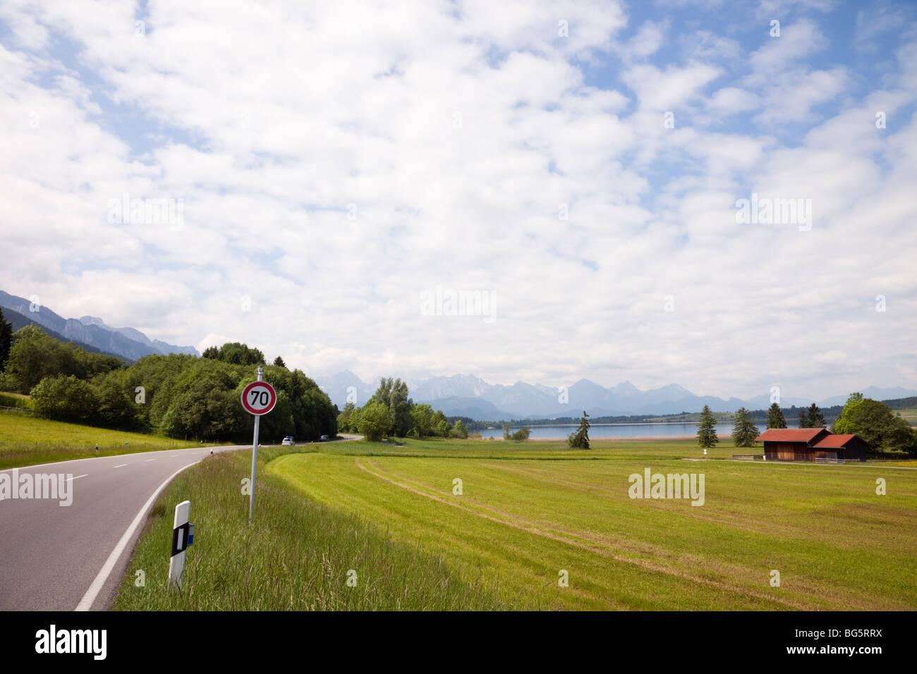 The Romantic Road (Romantische Strasse) tourist route near Lake Bannwaldsee in the Bavarian Alps. Schwangau Bavaria - Stock Image