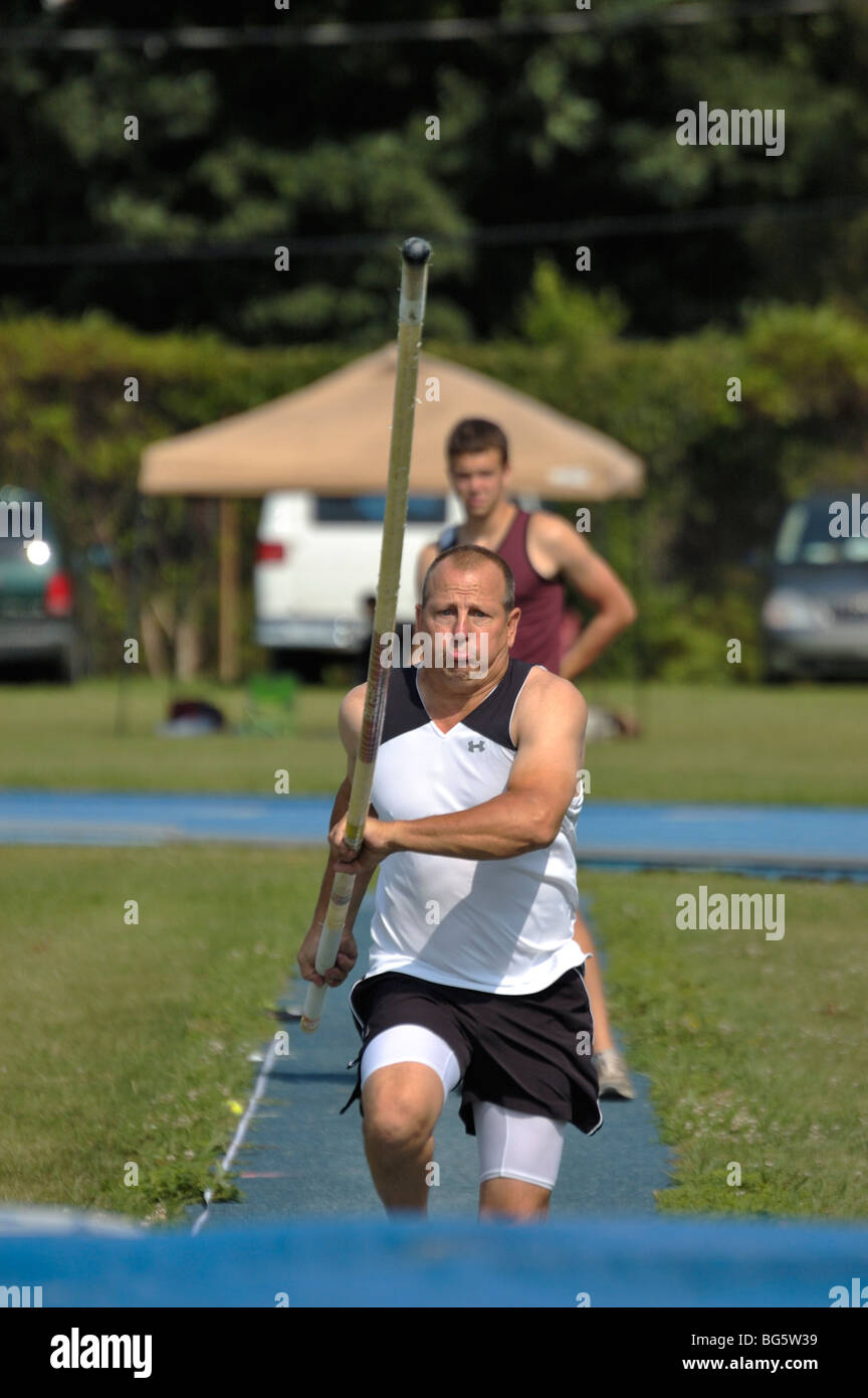 Adult man pole vaulter at the Track and Field competition during the Bluegrass State Games in Lexington, Kentucky - Stock Image