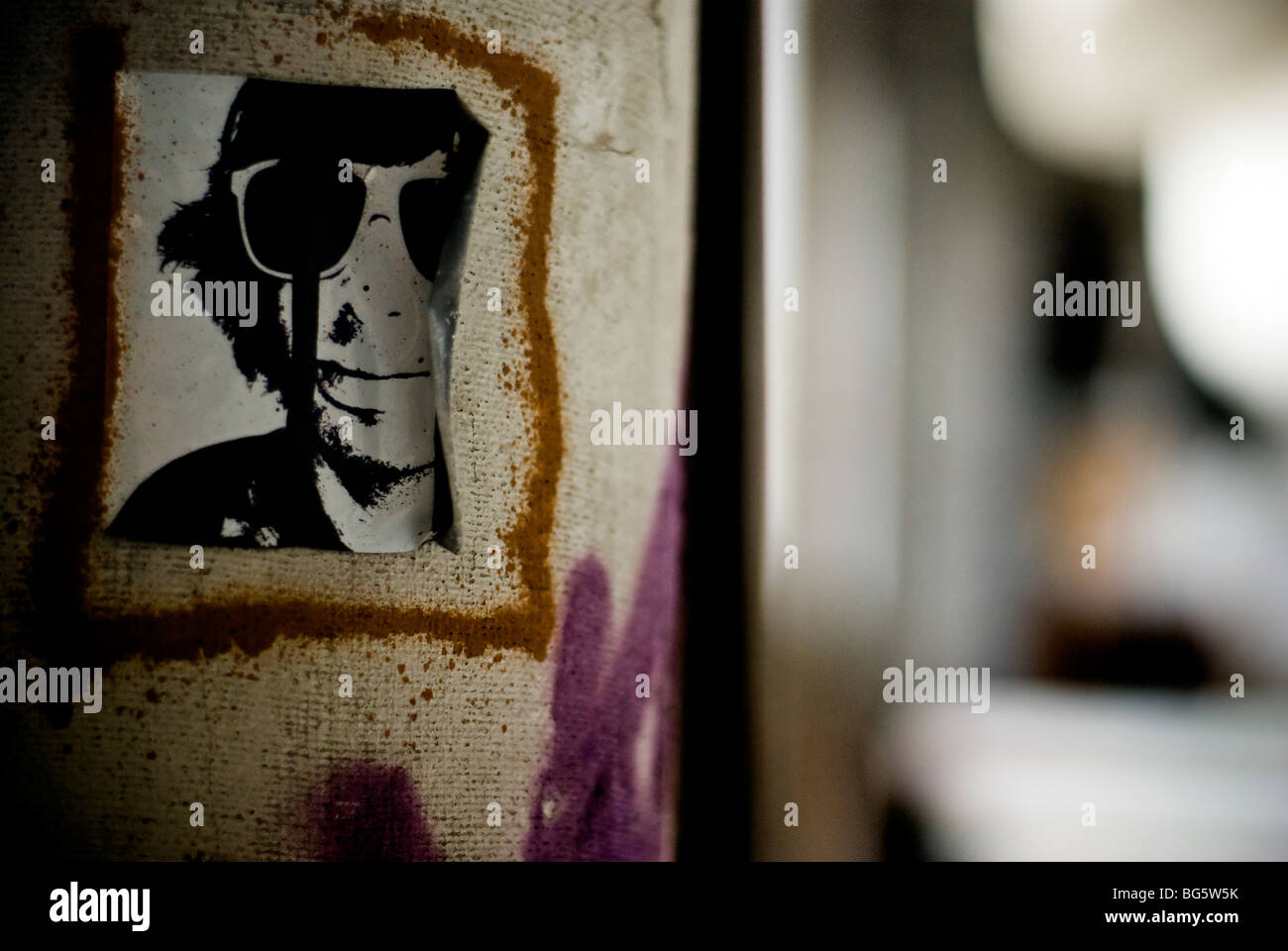 Sticker representing a face inside an old fabricate - Stock Image