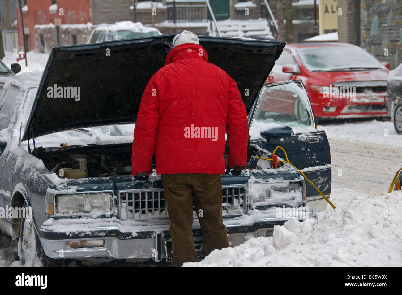 Boosting car battery in winter - Stock Image