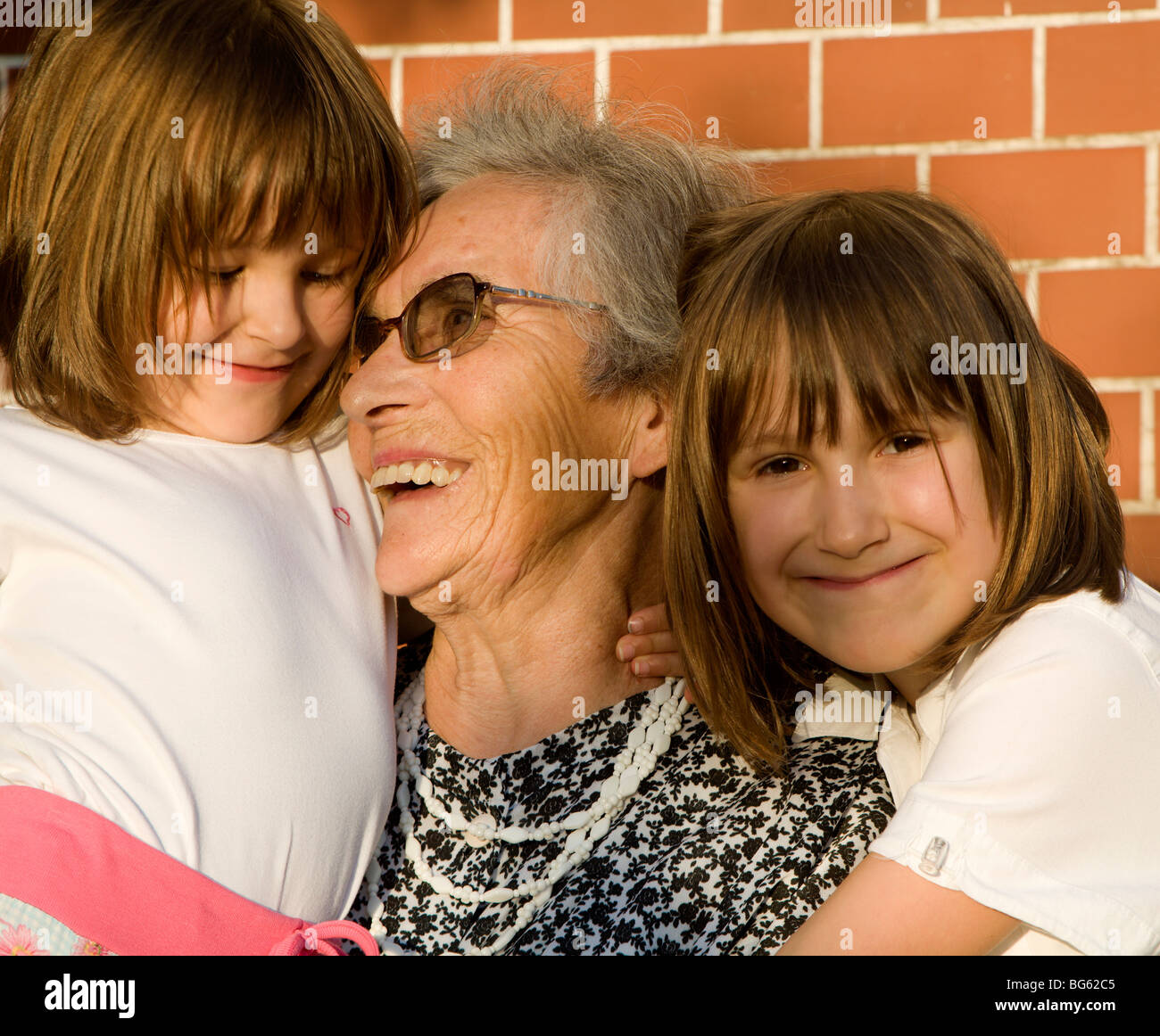grandmother and grand-daughters - Stock Image
