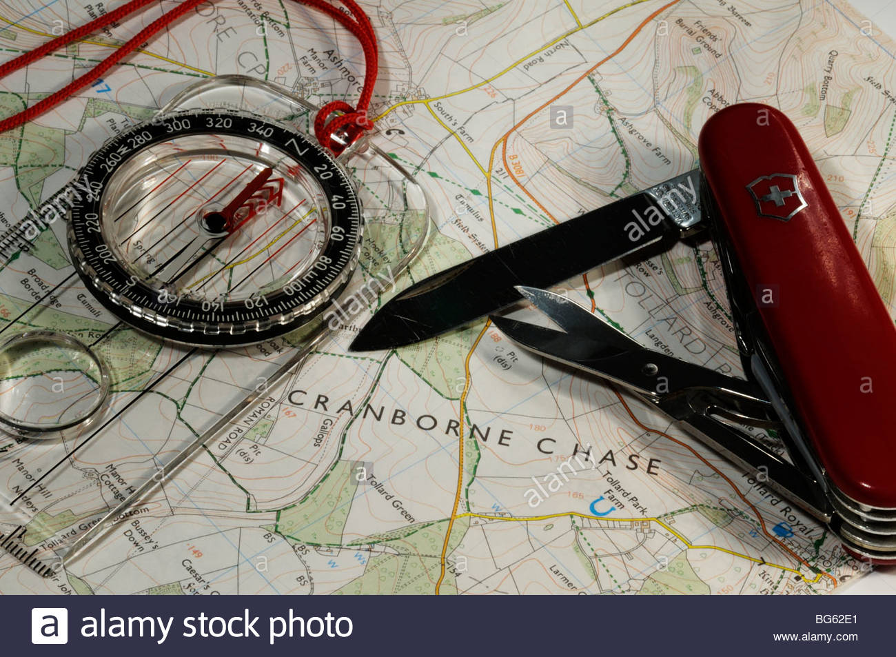 Close up image of the Cranborne Chase shown on map with compass and Swiss army knife, England, UK - Stock Image