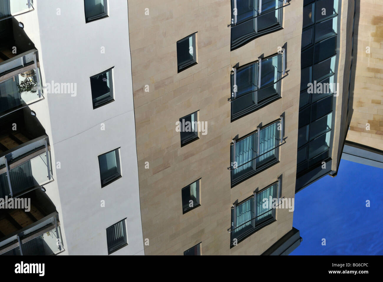 Multistorey apartment building reflected in water. Lancaster Canal, Lancaster, Lancashire, England, United Kingdom, - Stock Image