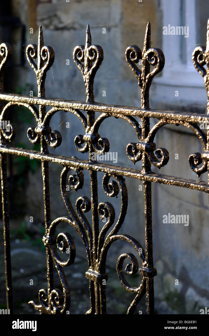 Iron railings by cottages in Blockley village, Gloucestershire, England, UK - Stock Image