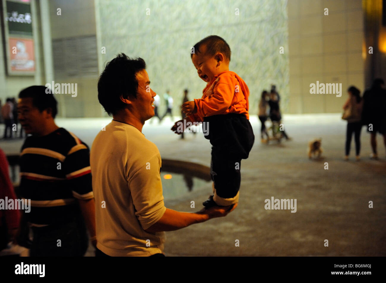 Father with his son in Shanghai, China. - Stock Image