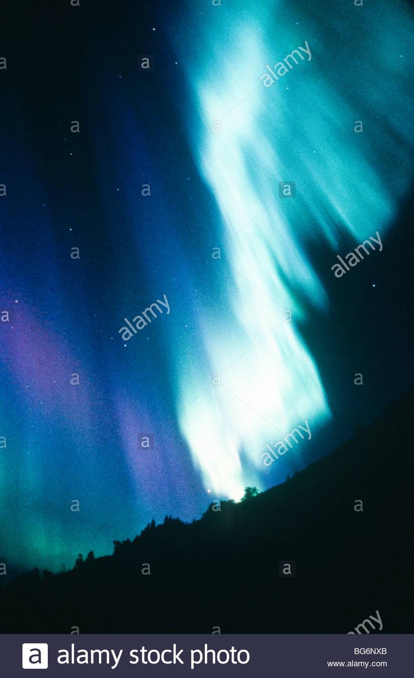 Alaska. In intense dislpay of northern lights (Aurora borealis) turns white hot. - Stock Image