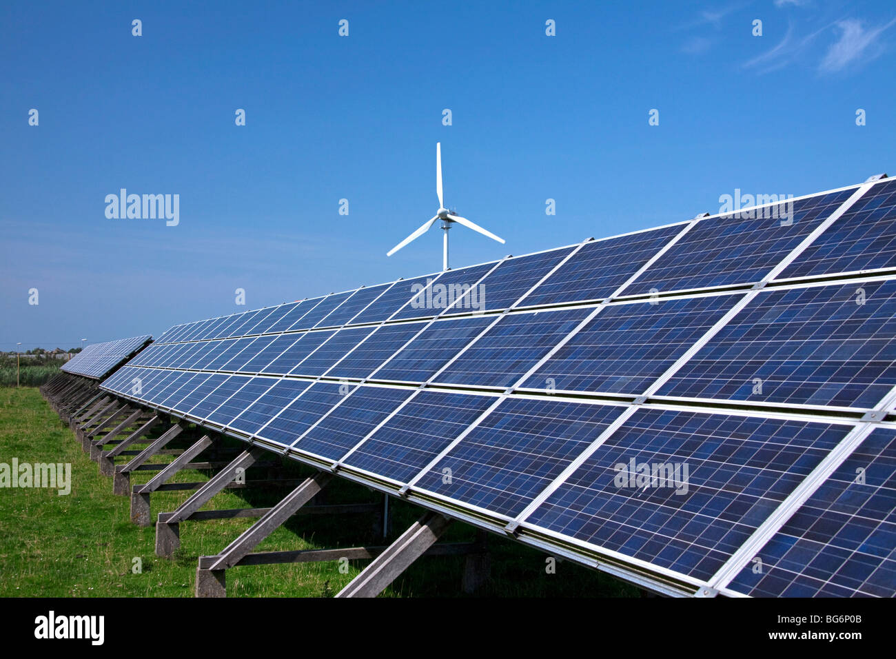 Wind turbine and photovoltaic solar panels for electricity production - Stock Image