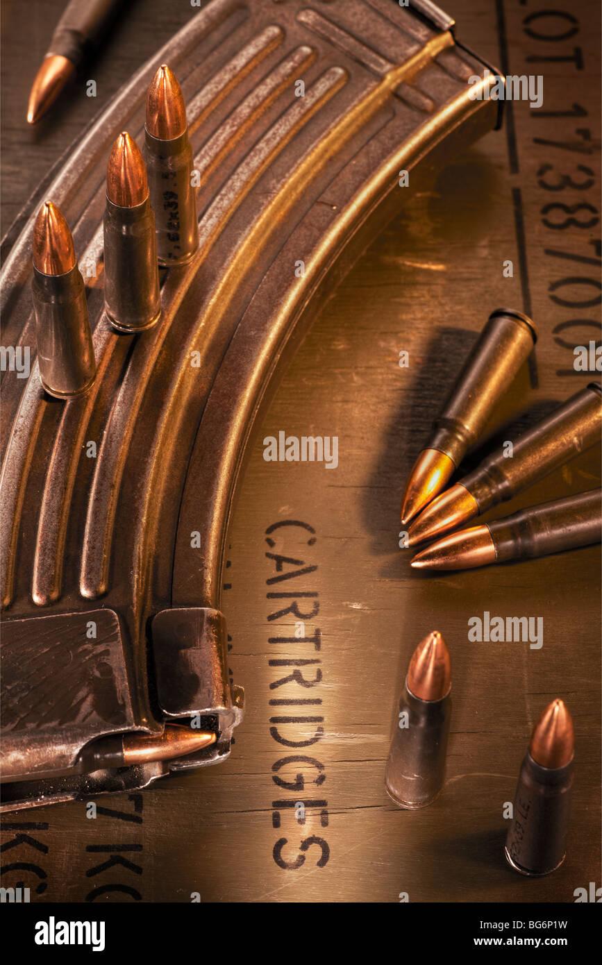 AK-47 clip, ammunition crate and assault rifle cartridges - Stock Image