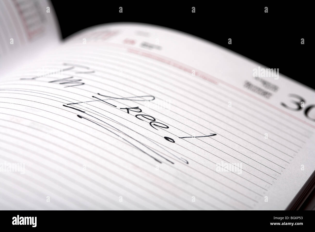 The phrase 'I'm free!' written on the page diary. Shallow DOF. - Stock Image