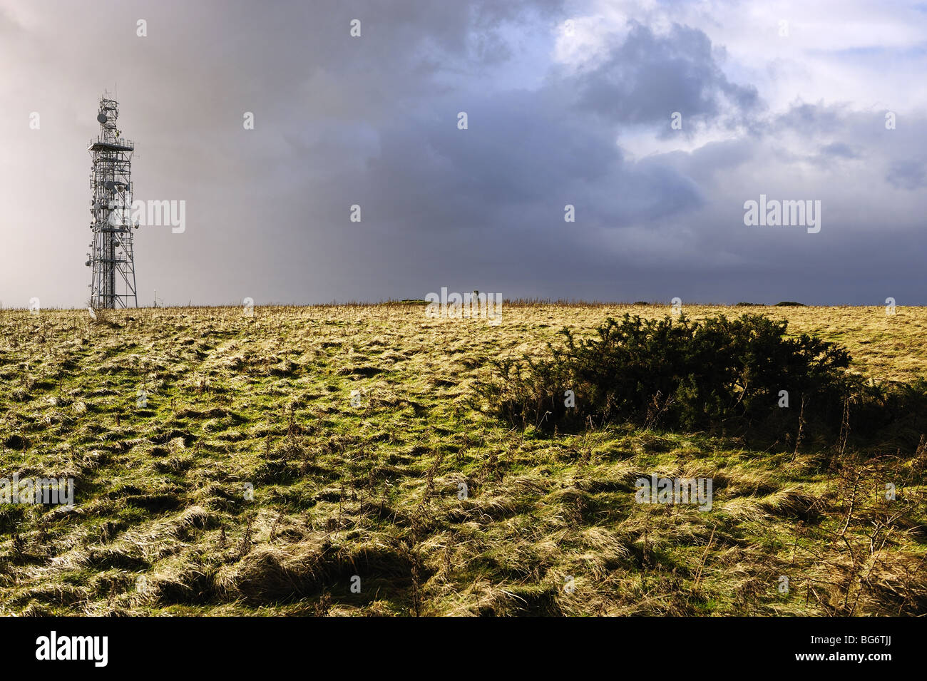 Autumn view of telecommunications mast before a rain storm on the summit of Butser Hill, near Portsmouth, Hampshire - Stock Image
