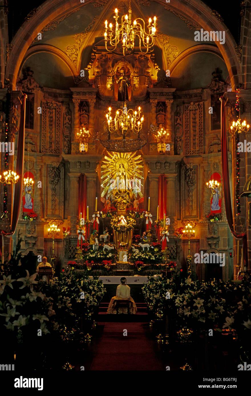 Mexican priest, main altar, quinceanera, San Francisco Church, Iglesia de San Francisco, San Luis Potosi, San Luis - Stock Image