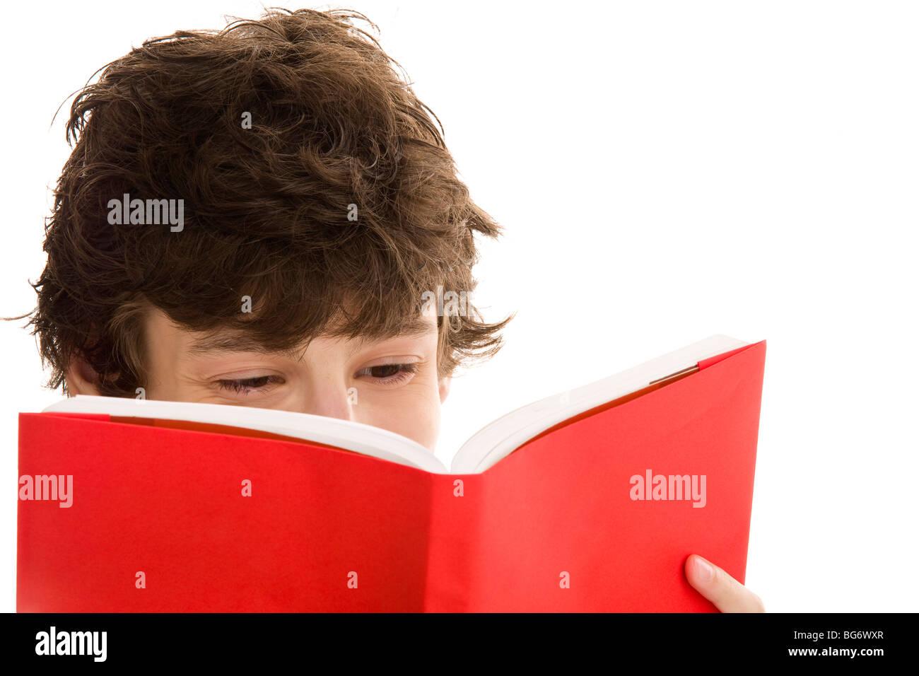 Teenage boy reading book isolated on white background - Stock Image