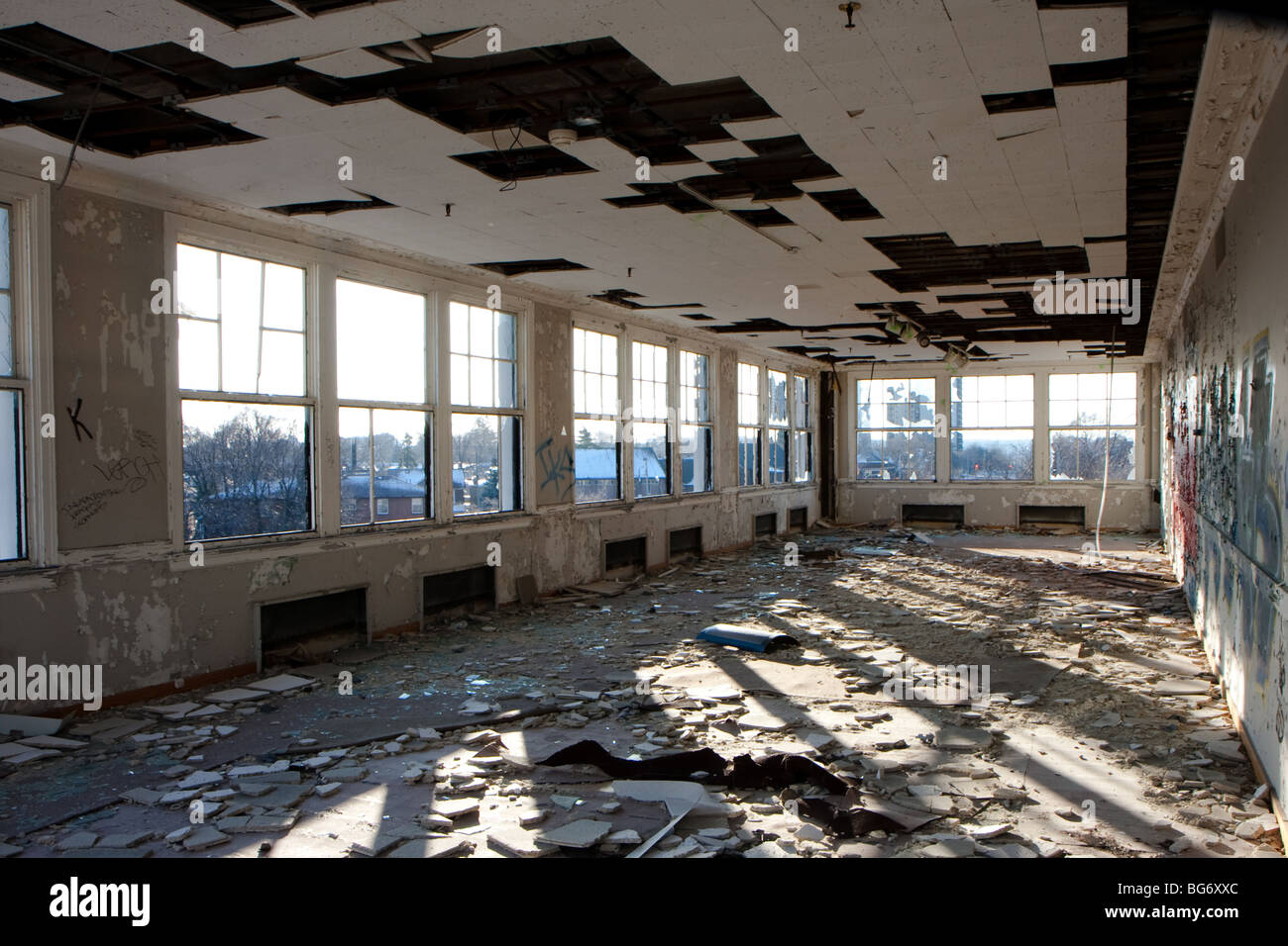 abandon industrial building interior broken window - Stock Image