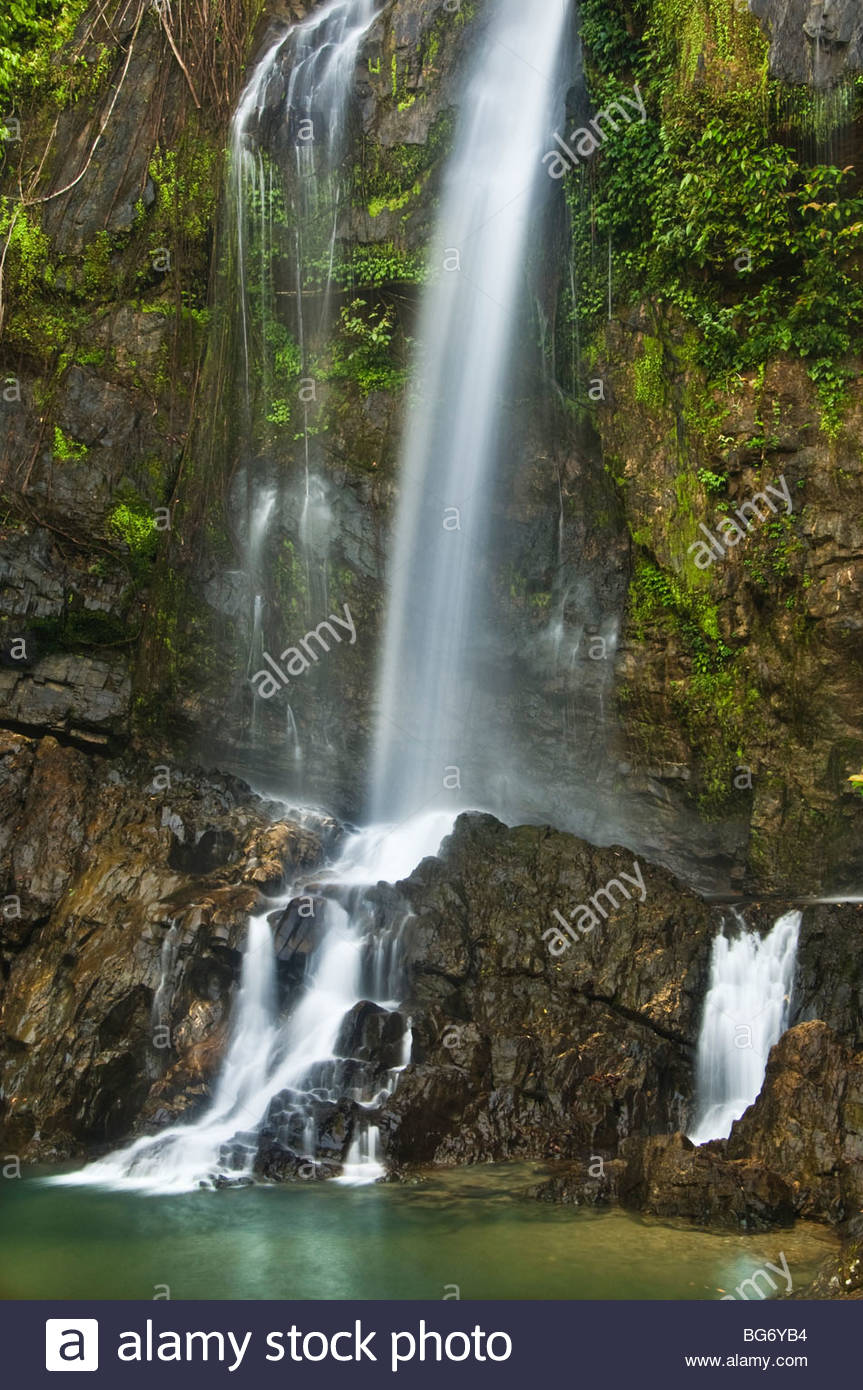 Cascading waterfall in the tropical rainforest. - Stock Image