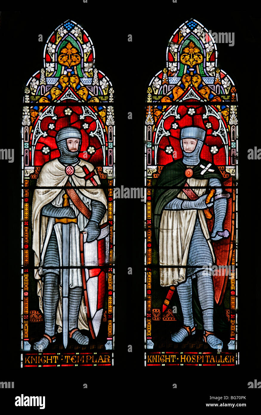 Detail of west stained glass window depicting Knights Templar and Hospitaller, Church of St Andrew, Temple Grafton, - Stock Image