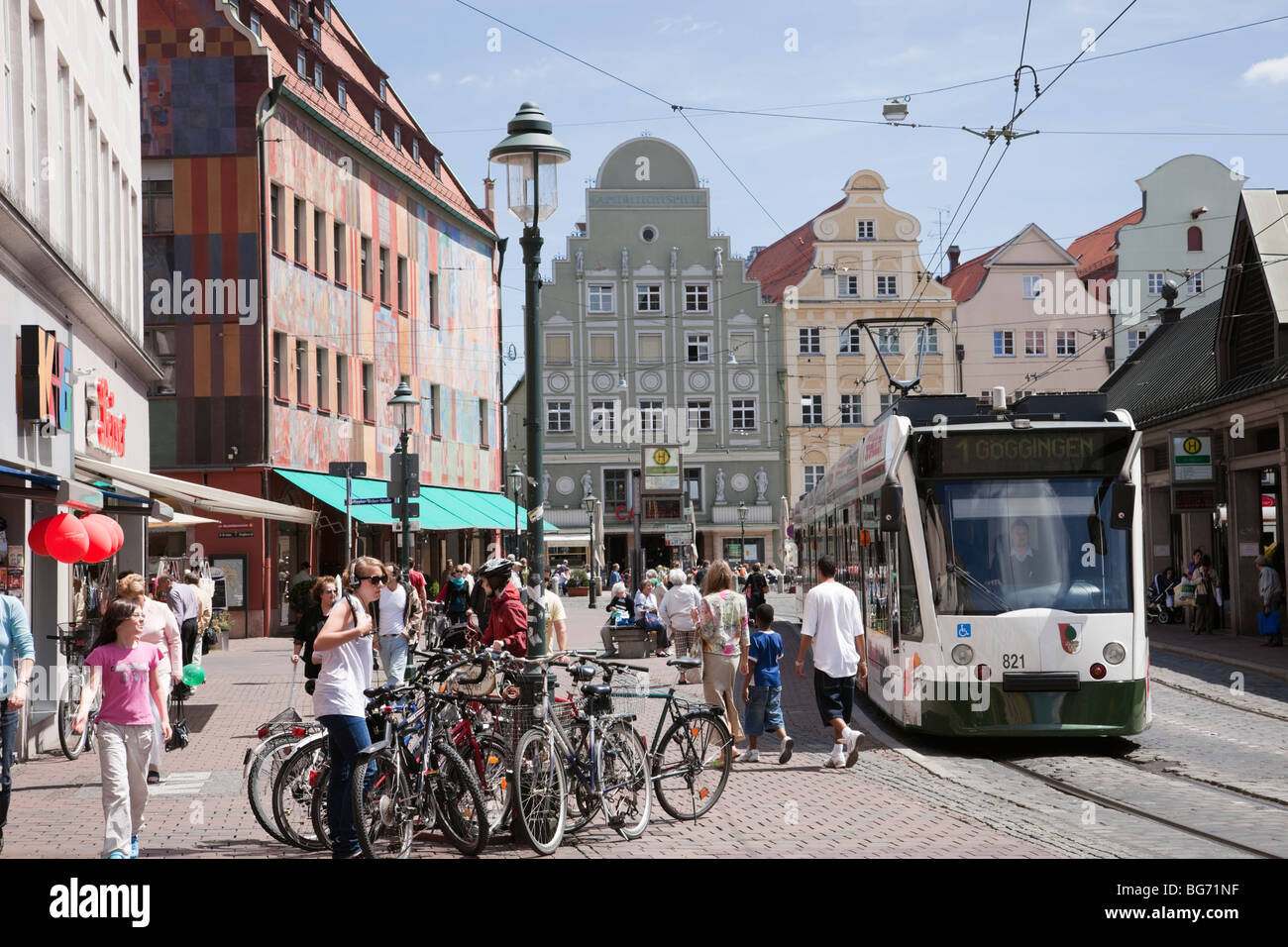 Moritzplatz, Augsburg, Bavaria, Germany, Europe. Parked bicycles and Tram on busy street in old city centre. - Stock Image