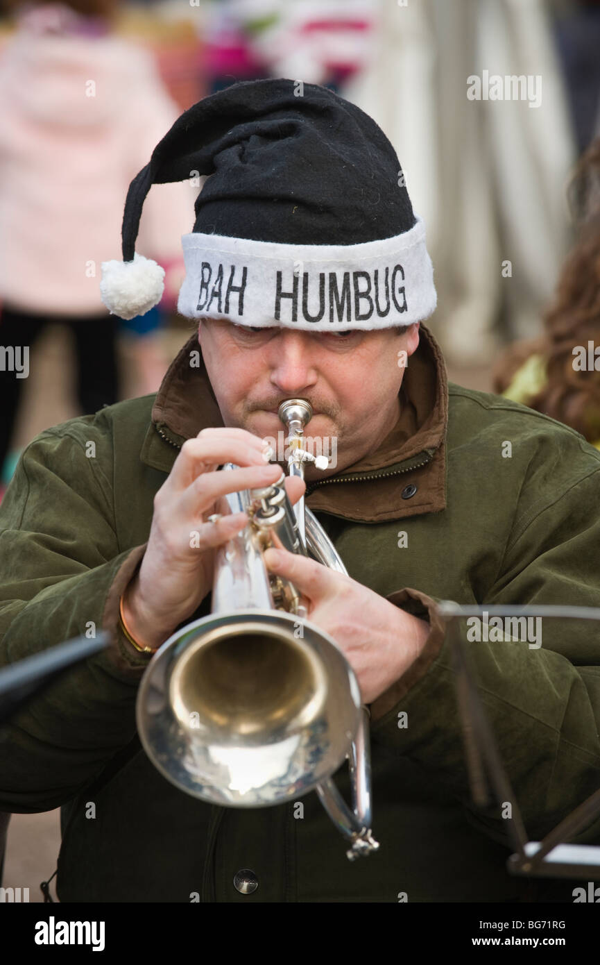 Usk Town Band playing Xmas carols duing Usk Winter Festival Usk Monmouthshire South Wales UK  trumpet player hat - Stock Image