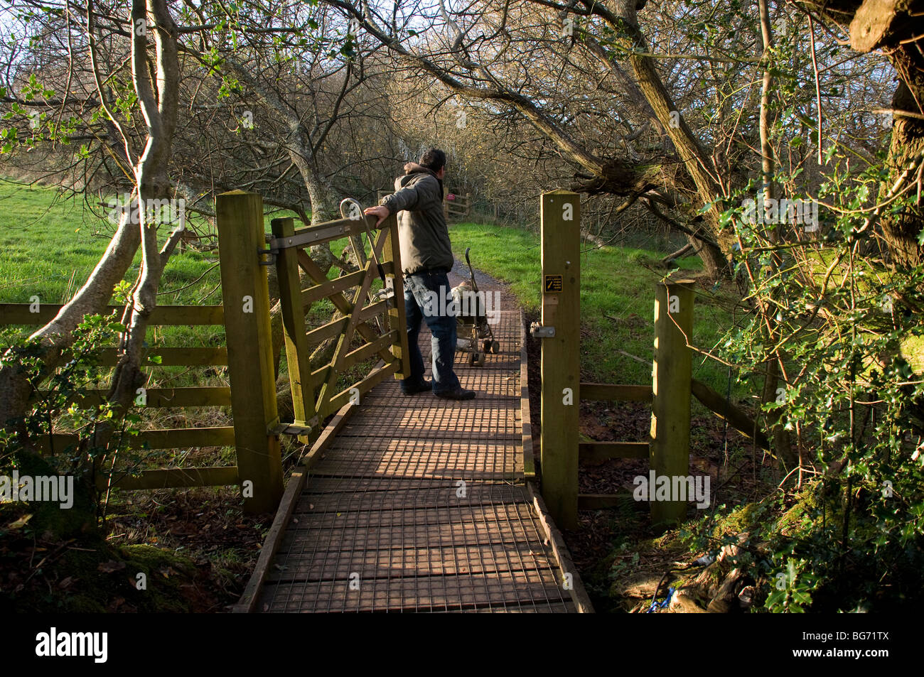 Occombe Farm is an organic farm in Paignton,South Devon,a young father pushes a pushchair around a 2km easy-access - Stock Image