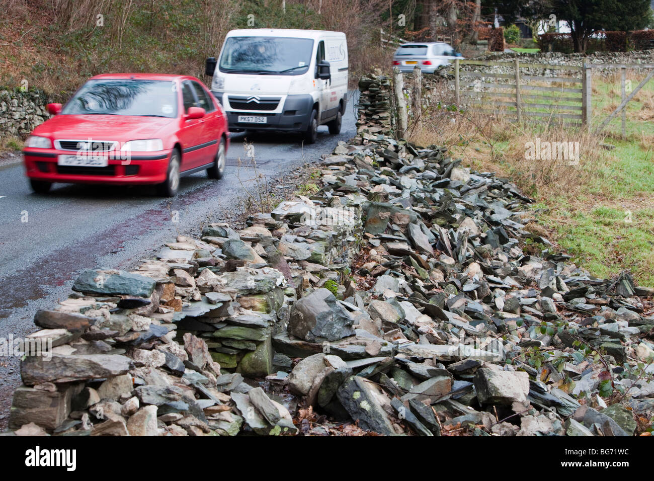 Dry stone walls demolished by the weight of floodwater in Langdale, in the november 2009 floods. - Stock Image