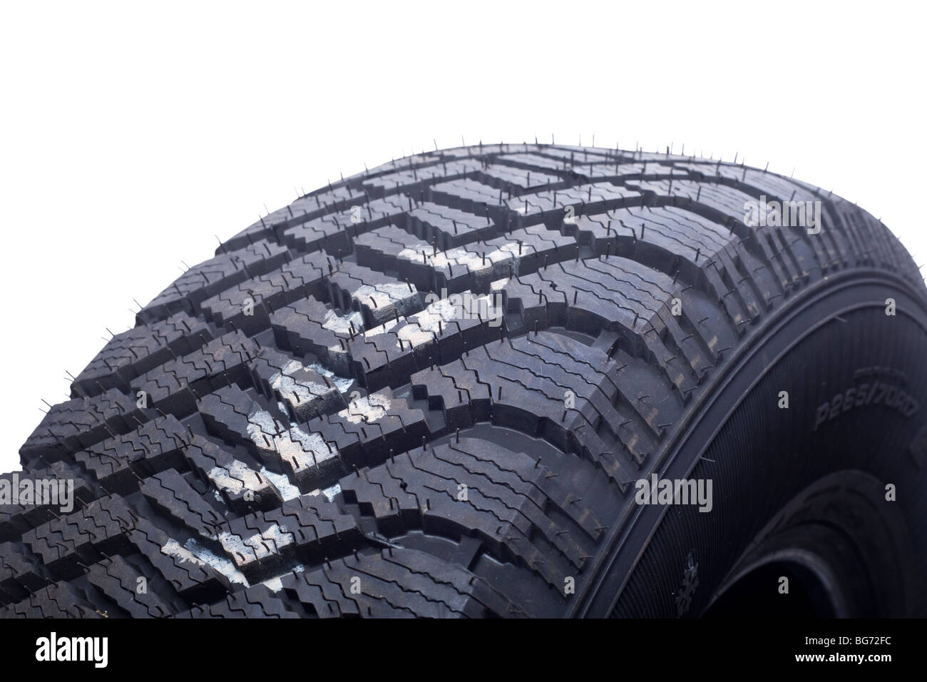 close up of winter tire tread on white background - Stock Image