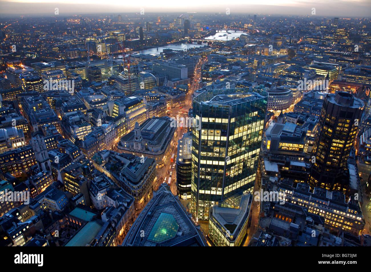 Evening aerial view from old broad street looking over Bank City of London down Threadneedle Street over Thames - Stock Image