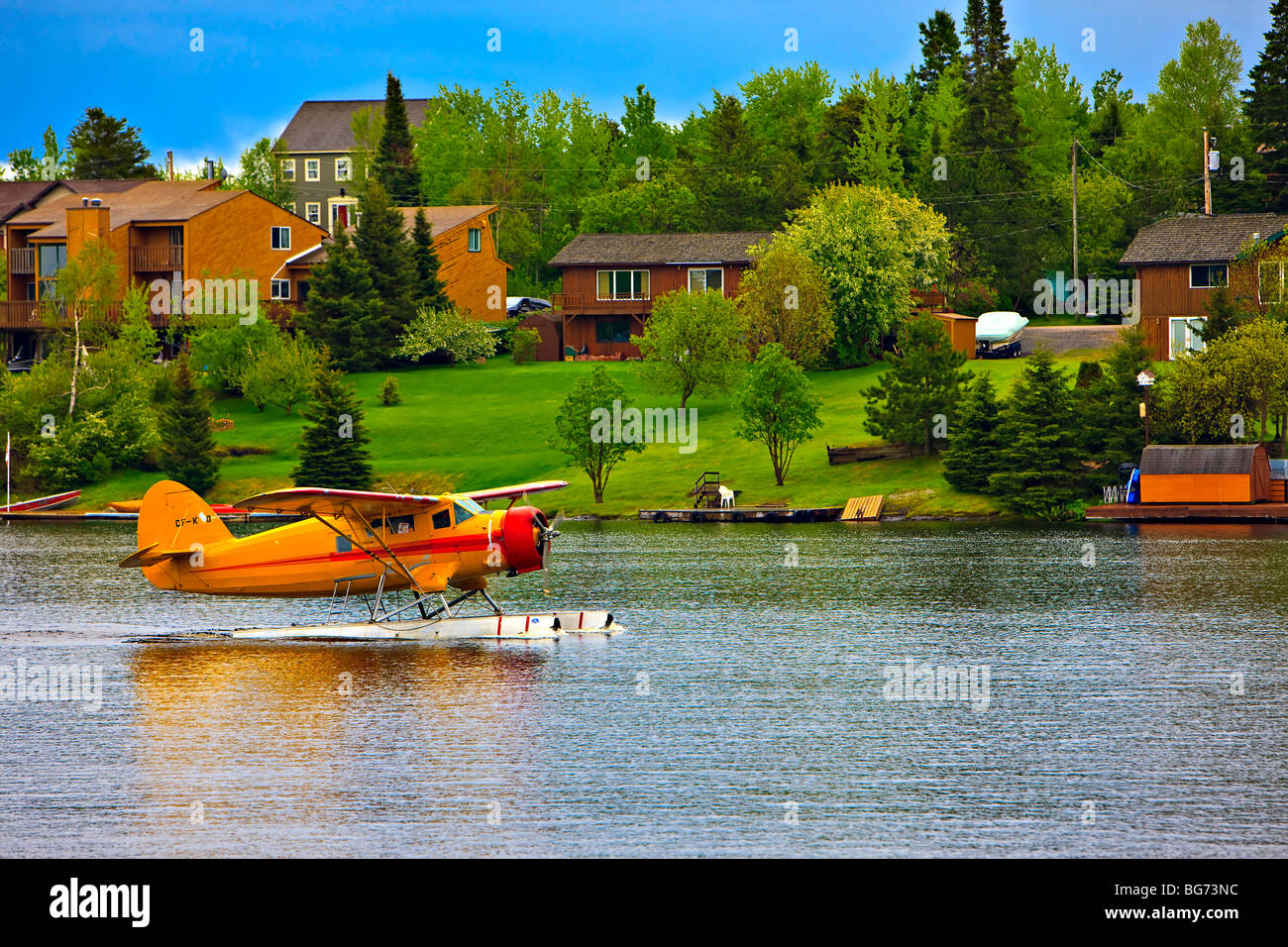 Norseman aircraft taxiing on the water in the town of Red Lake, Ontario, Canada. - Stock Image