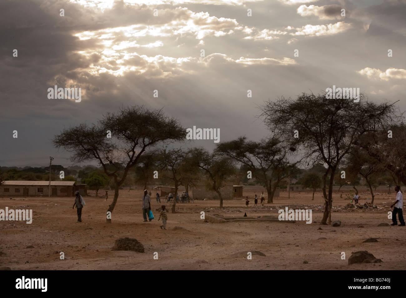 The sun shines through the clouds in the Tanzanite mining town of Mererani, Tanzania. - Stock Image