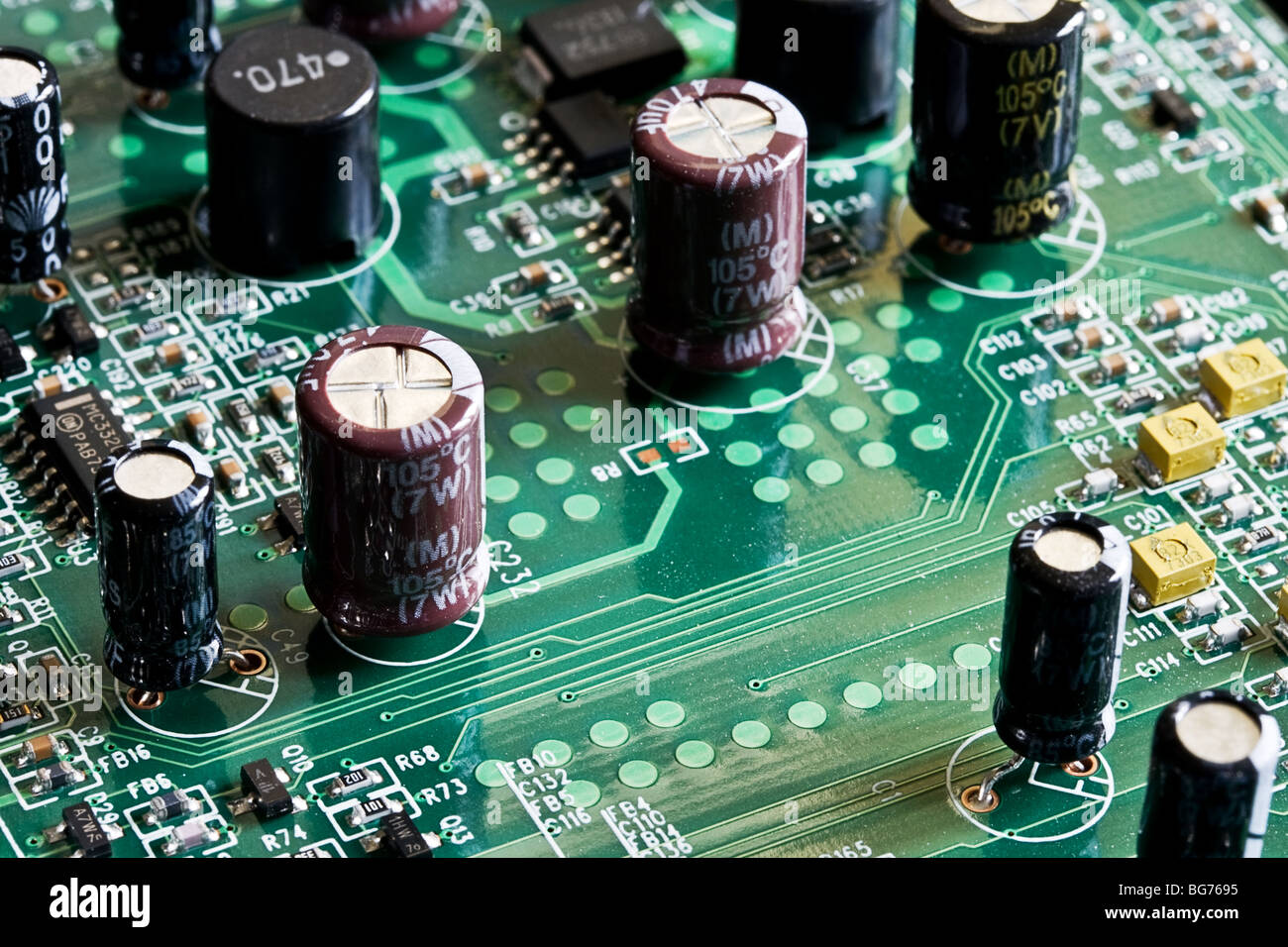 Close up photograph of a circuit board and electrical components ...