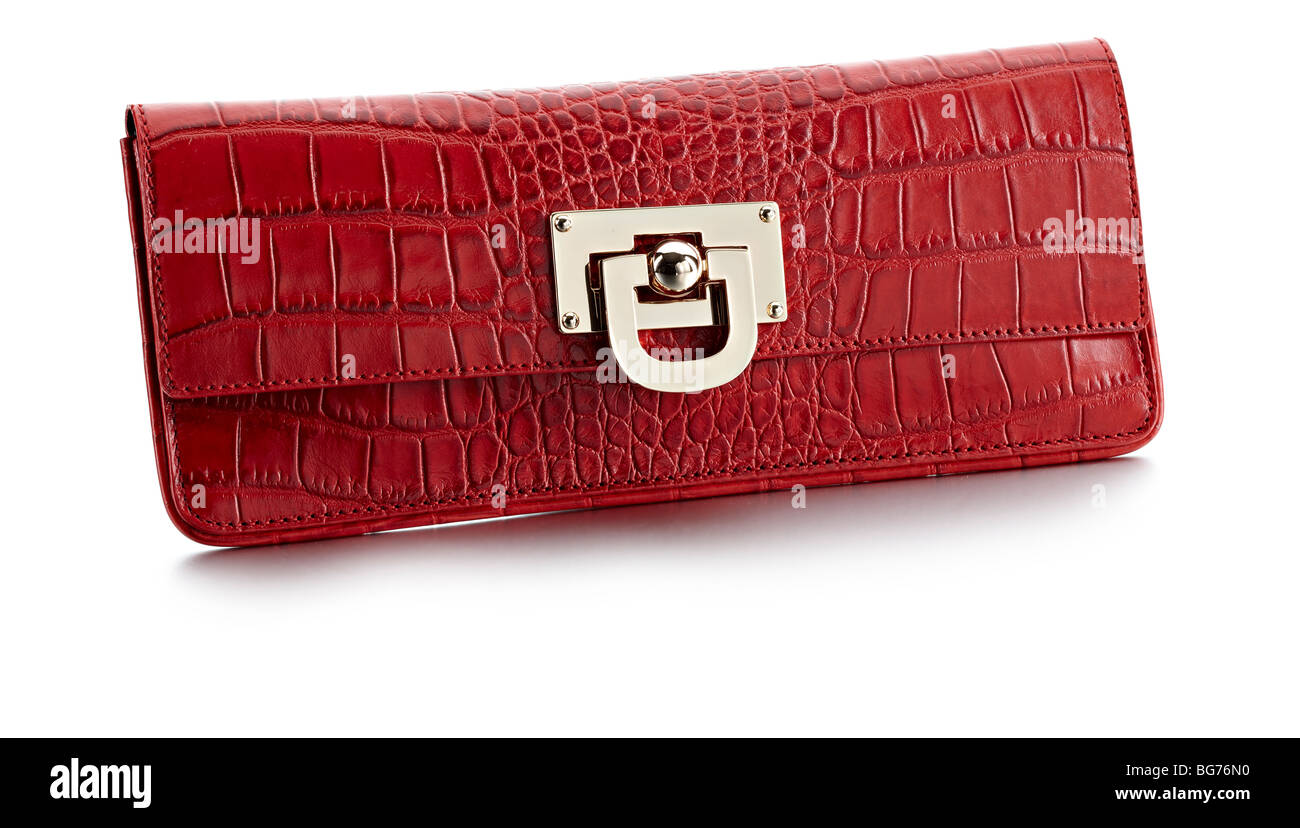 red crocodile effect skin clutch bag - Stock Image