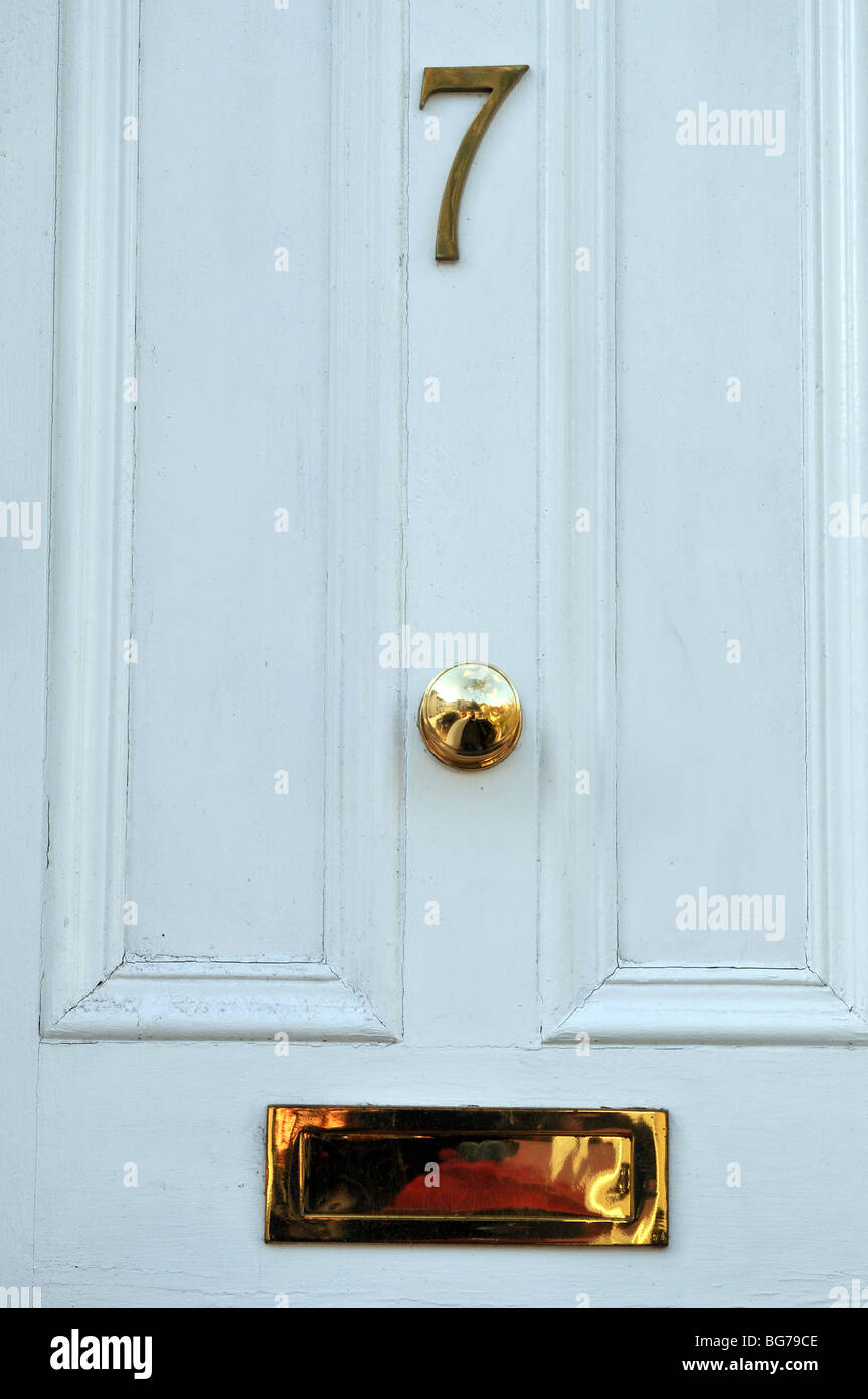 Charmant Door Number 7. House Seven.   Stock Image
