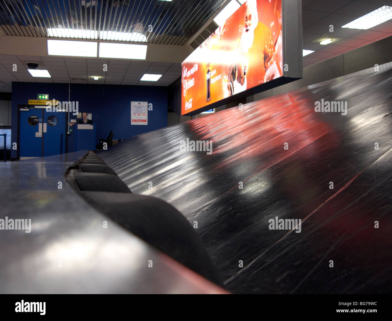 empty stopped baggage reclaim carousel at belfast international airport uk - Stock Image