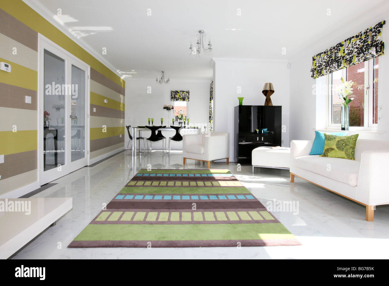 Stylish and modern lounge room with marble tiled floor. Very bright ...