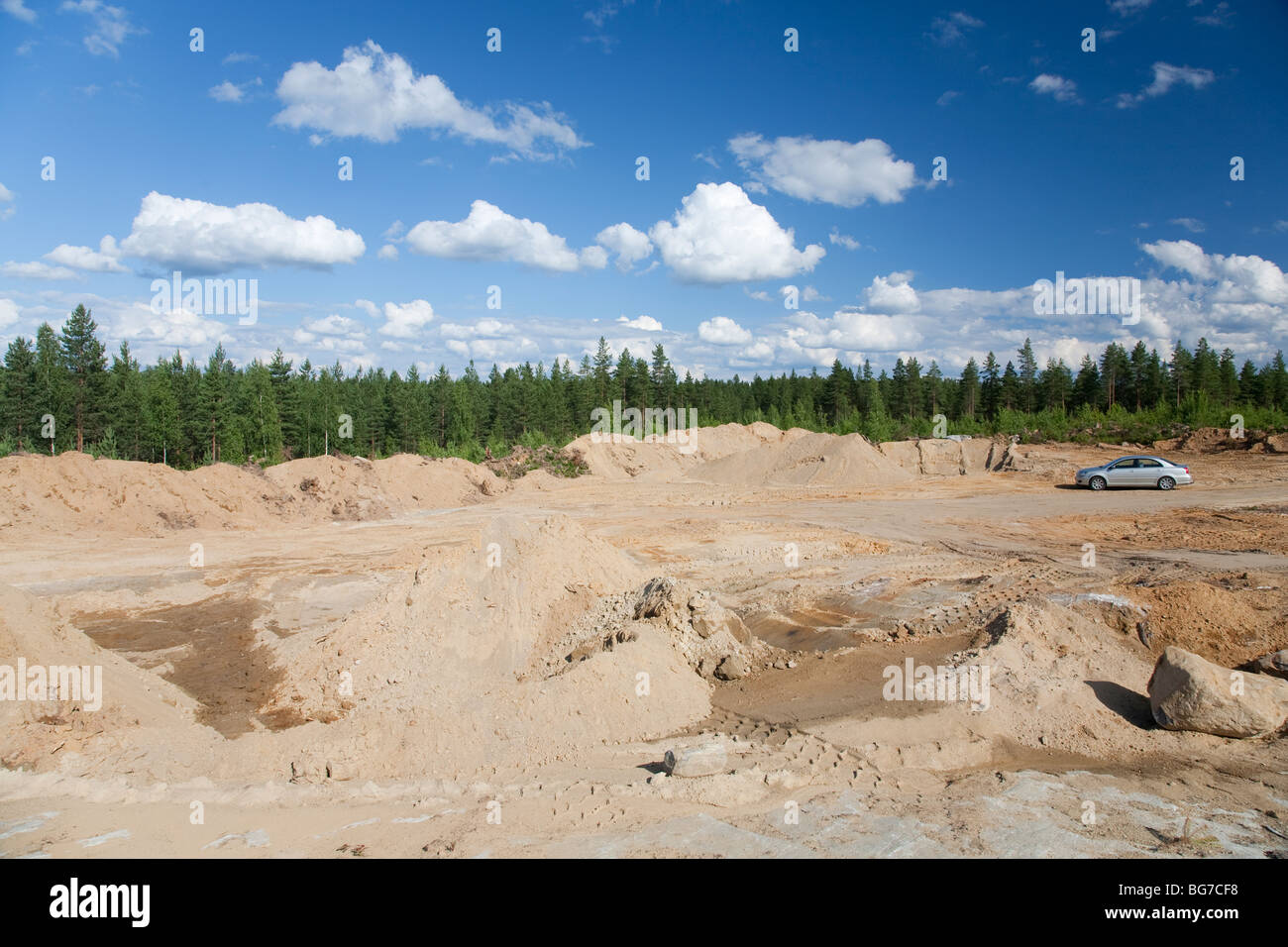 Exposed bedrock in a site where a new rock quarry will start digging for sand and crushing the bedrock to gravel - Stock Image