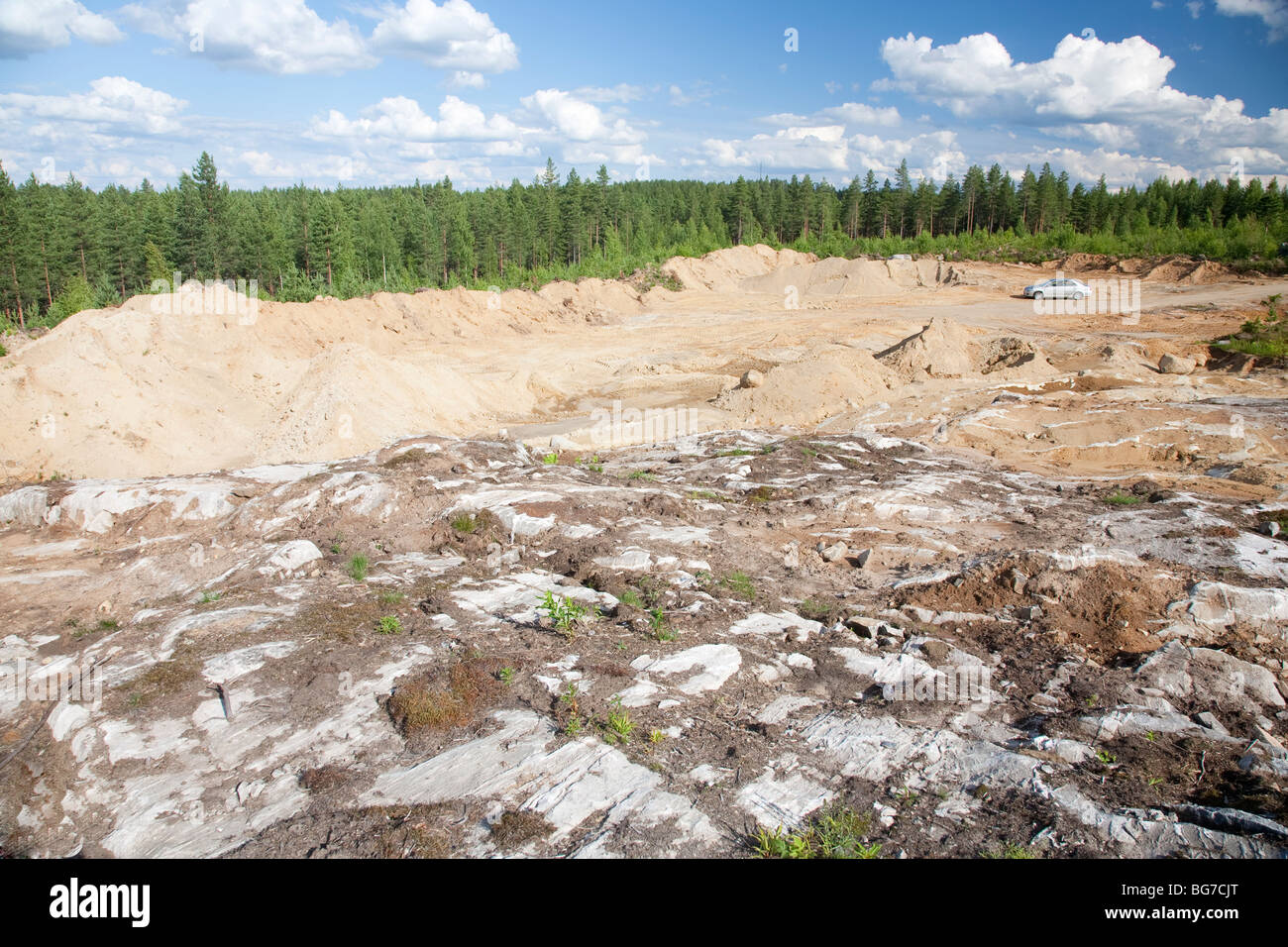 Exposed bedrock at a new rock quarry for digging for sand and crushing the bedrock to gravel , Finland - Stock Image