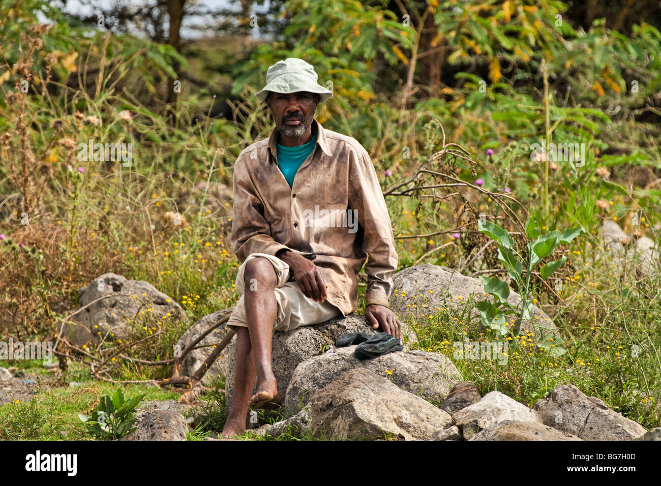 Sitting safari walk guide in Africa - Stock Image