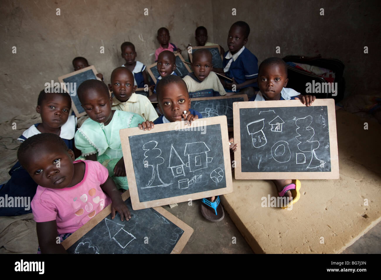 Young children display drawings in an orphanage in Amuria, Uganda, East Africa. - Stock Image