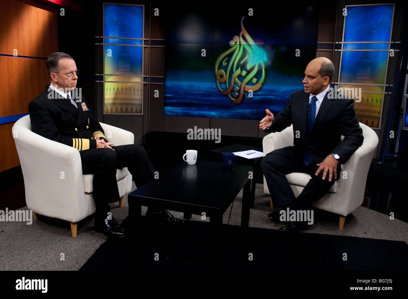 Staff Navy Adm. Mike Mullen interviewed by Abderrahim Fouka, of the Al Jazeera television network. Stock Photo