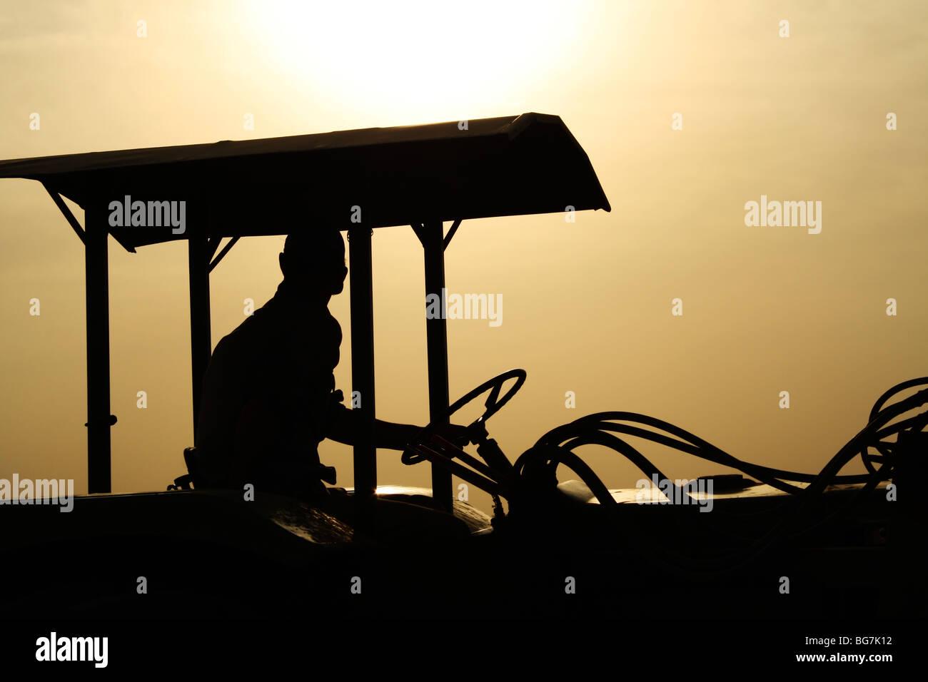 A chiaroscuro of a farm worker - Stock Image