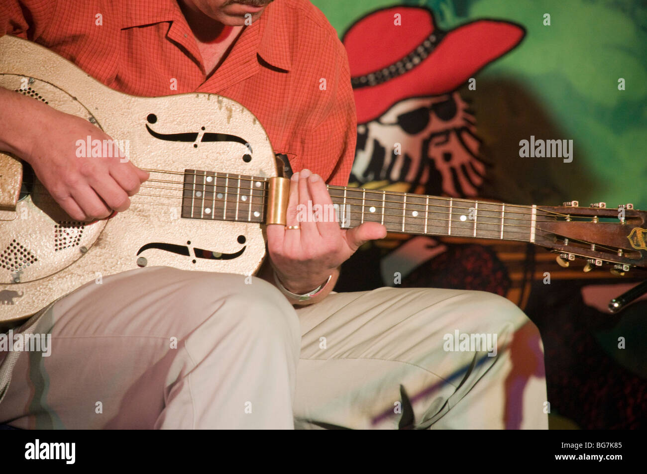 Israel, Nof Ginosar, Jacob's Ladder Music festival, guitarist uses a bottleneck - Stock Image