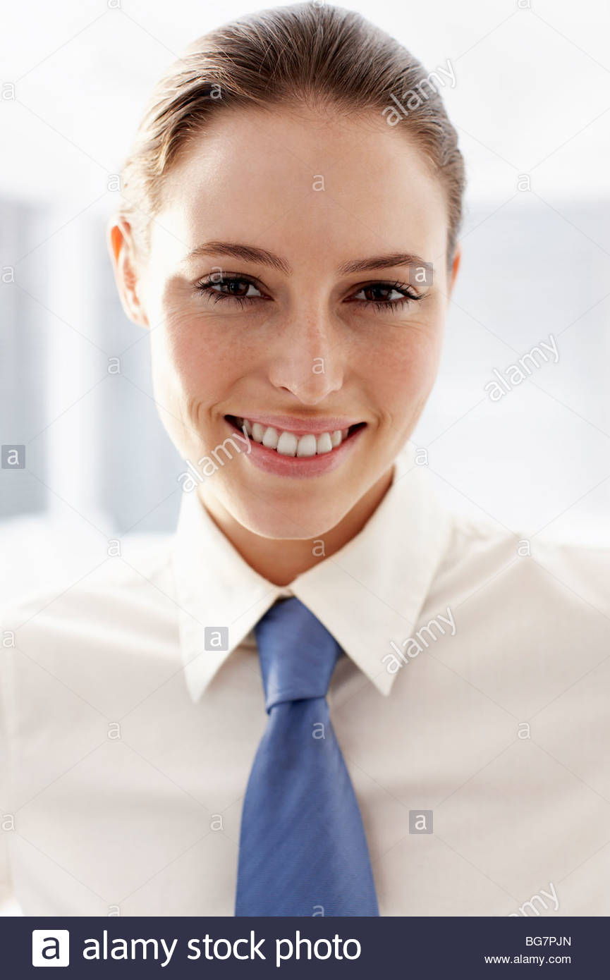 Businesswoman wearing tie - Stock Image