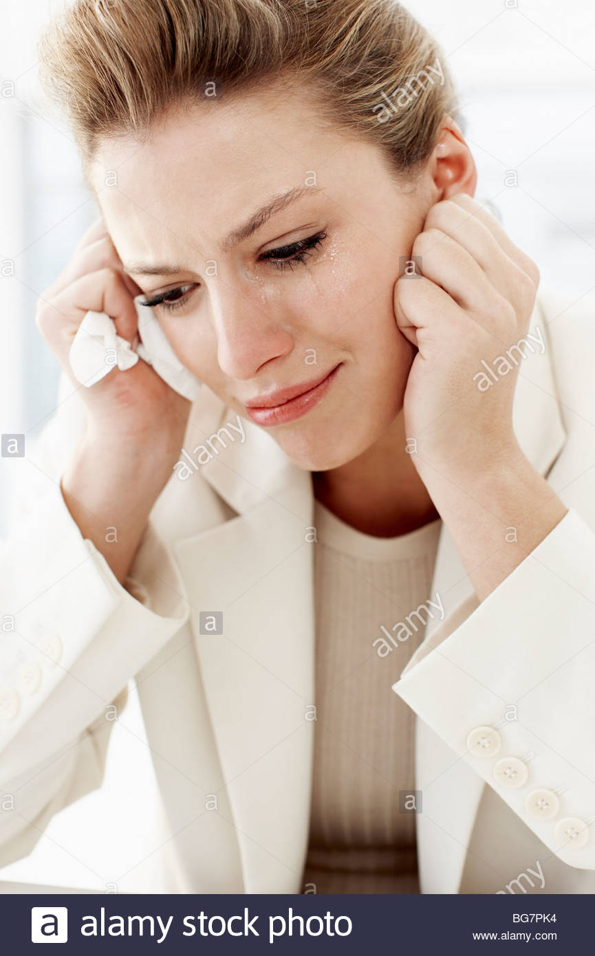 Businesswoman crying - Stock Image