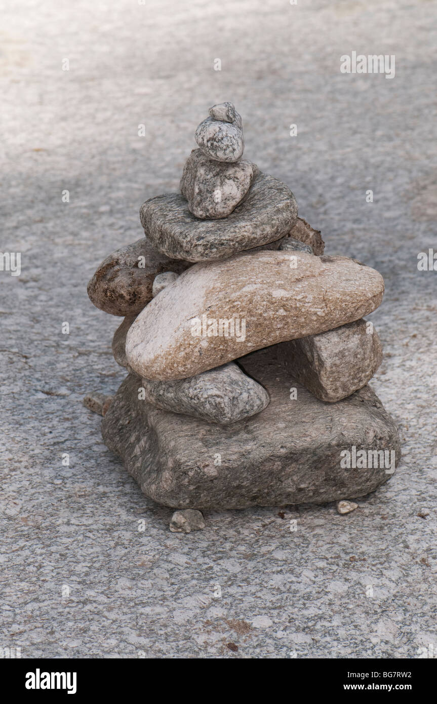 Cairn placed for signaling the correct path for mountain hikers, Pyrenees, Spain - Stock Image