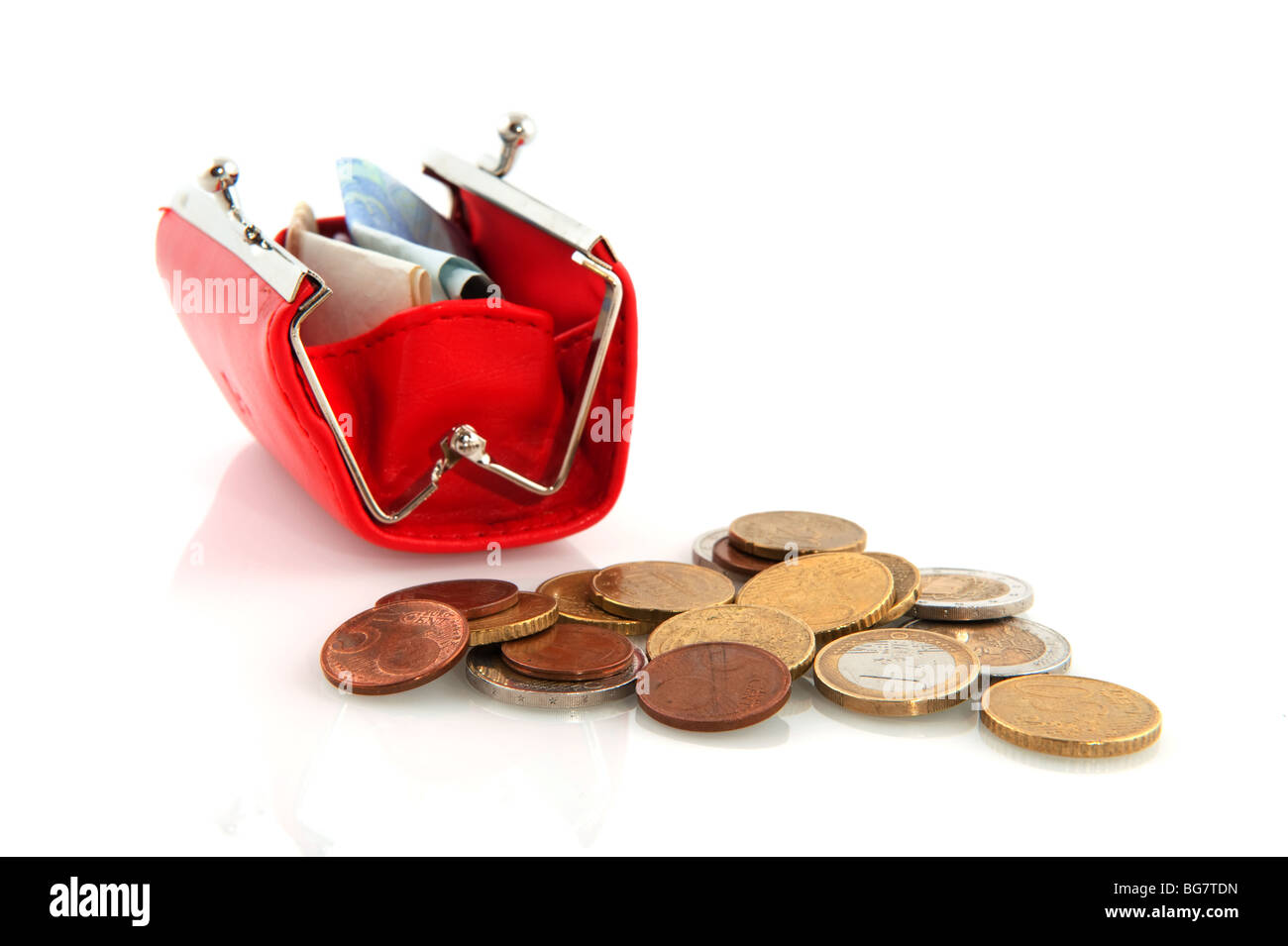 coins and banknotes in a red purse - Stock Image