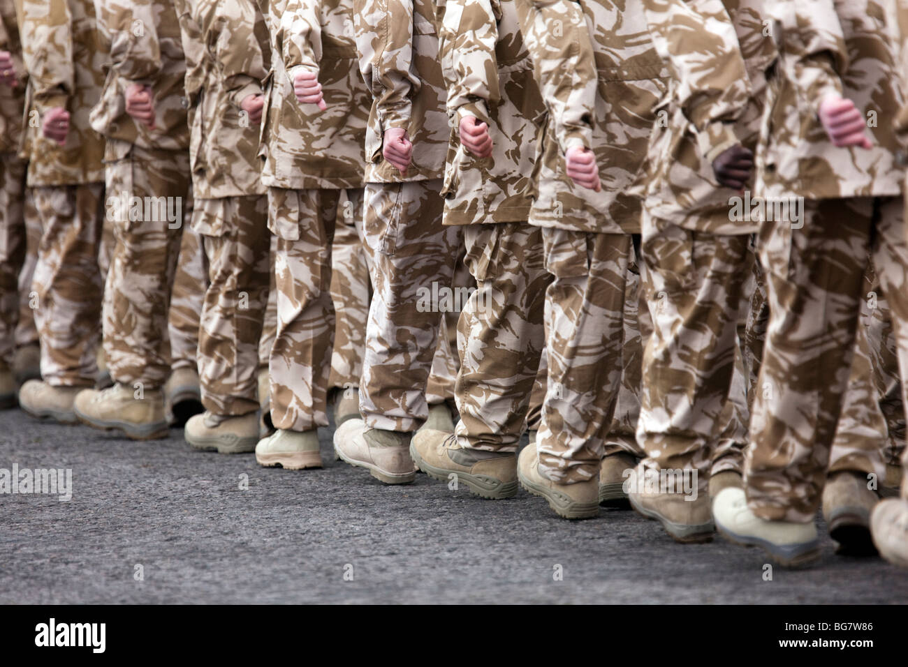 British soldiers from the 4th Battalion The Rifles in desert uniform on the parade ground at Bulford Camp, Wiltshire, - Stock Image