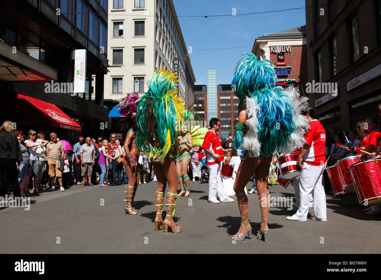 Finland, Helsinki, Helsingfors, Street Dancers, Women Performers Wearing Colourful Costumes, Rear View - Stock Image
