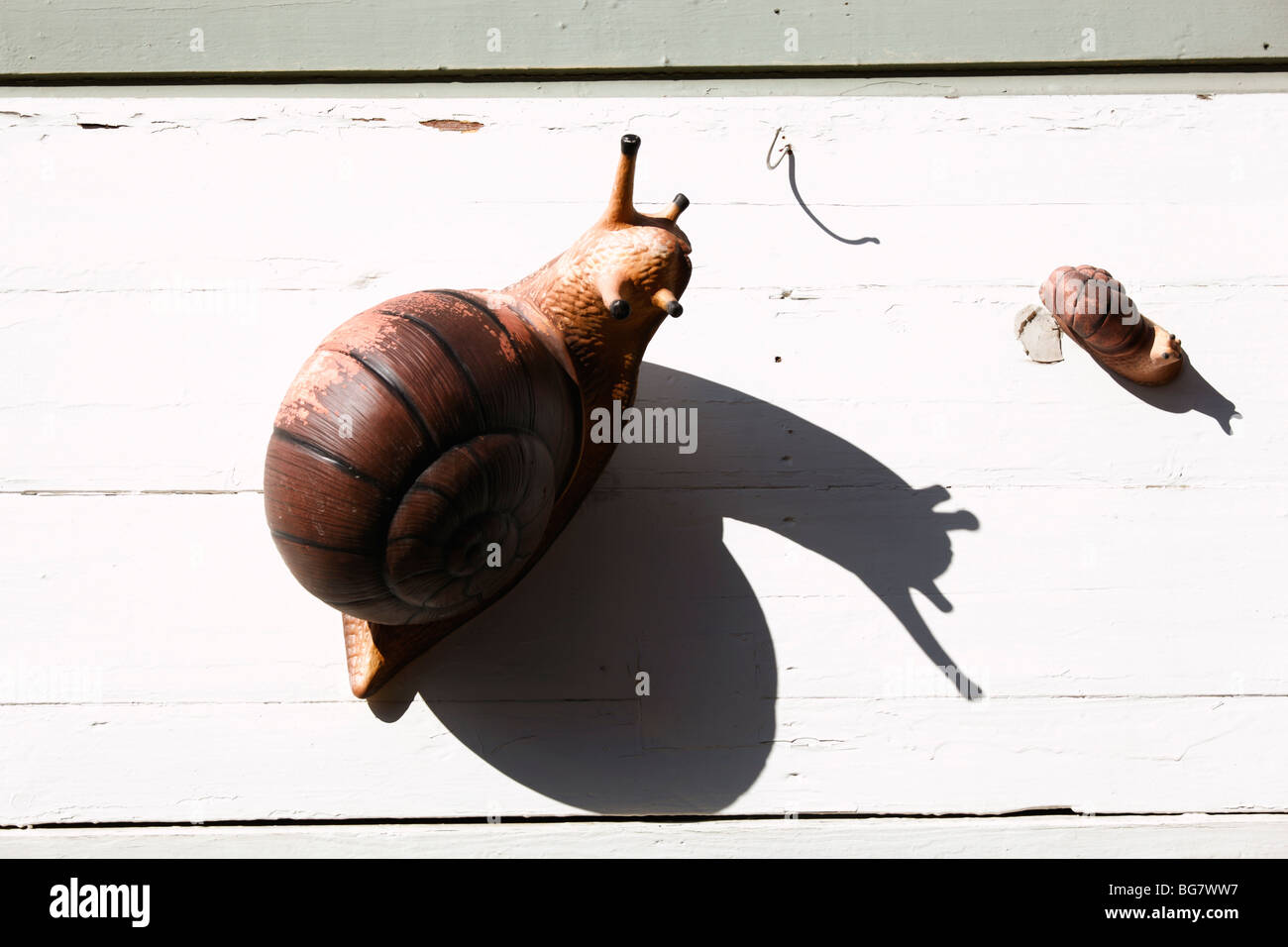 Finland, Southern Finland, Eastern Uusimaa, Porvoo, Snails Decorating Wooden Wall - Stock Image