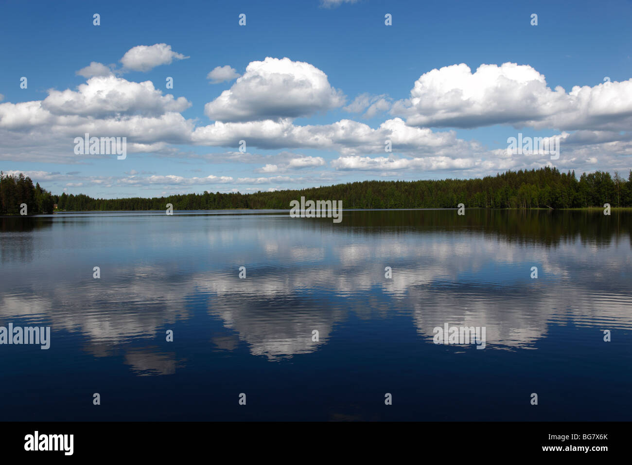 Finland, Region of Southern Savonia, Savonlinna, Saimaa Lake District, Clouds Reflected in Lake Puruvesi - Stock Image