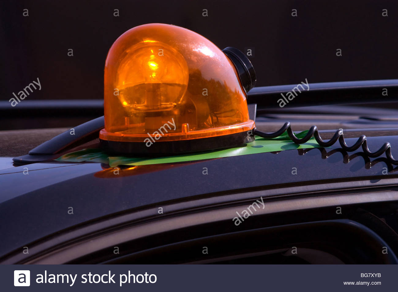 yellow roof light on car - beacon rotate - Stock Image