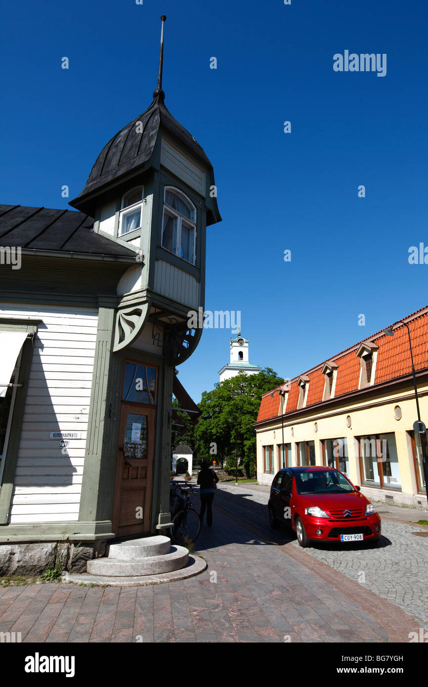 Finland Region of Satakunta Rauma Old Town Wooden House Quarter Historic Street Housing Red Car Tower of Church - Stock Image