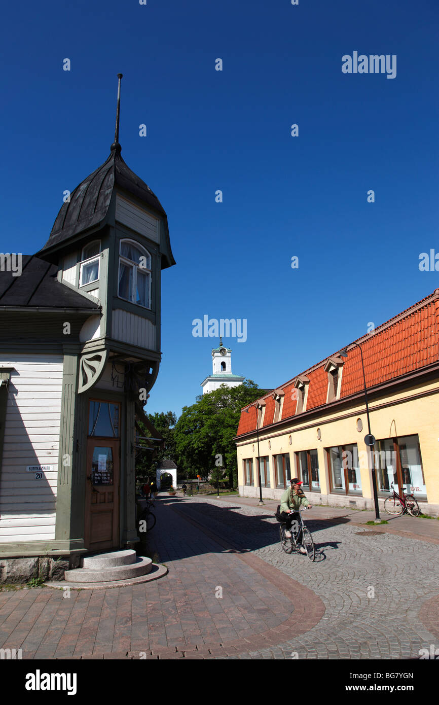Finland Region of Satakunta Rauma Old Town Wooden House Quarter Historic Street Housing Cyclist Tower of Church - Stock Image